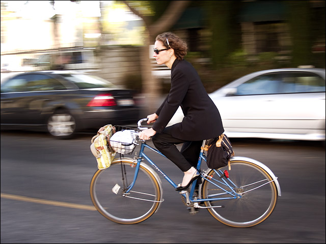 Gina riding home from a meeting